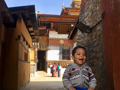 The 2 year old sitting on the steps of a 12th century monastery, Changangkha Lakhang, Thimphu, Bhutan. Samai Haider