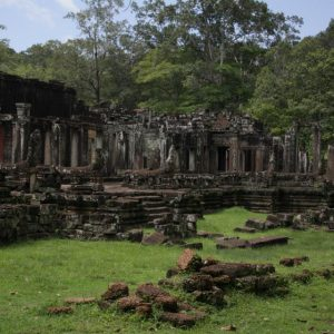 Temple ruins rise out of the jungle