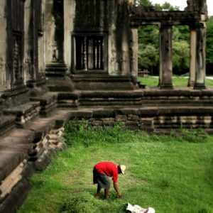 A gardener tending to the grounds of Angkor Wat