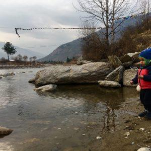 Throwing rocks into the Paro River, Bhutan