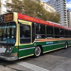 A local bus trundles down bustling Avenida Santa Fe, Buenos Aires