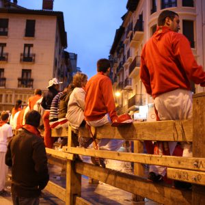 Spectators line the barriers at the crack of dawn.