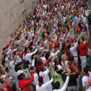 The runners chant prayers before the start of the race.